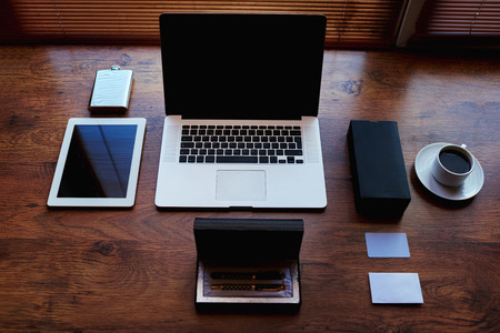 wireless network: Successful businessman or entrepreneur workspace with style accessories, pen case, open laptop computer and digital tablet with white blank copy space screen, private office table of wealthy person