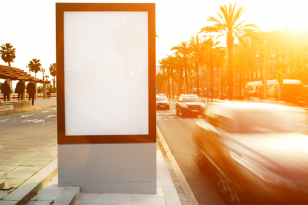 Blank billboard outdoors, outdoor advertising mock up, public information board on city road, flare sun light Stock Photo