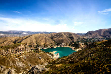 outoors: Scenery of high mountains with green water lake, view of mountain lake surrounded by high peaks