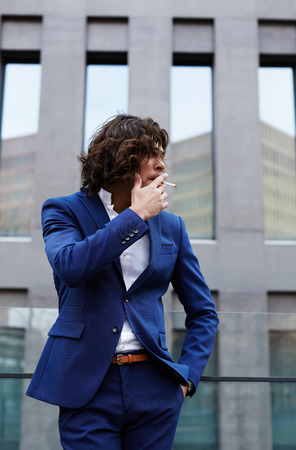 moneymaker: Portrait of a smart business executive smoking cigar looking concerned Stock Photo