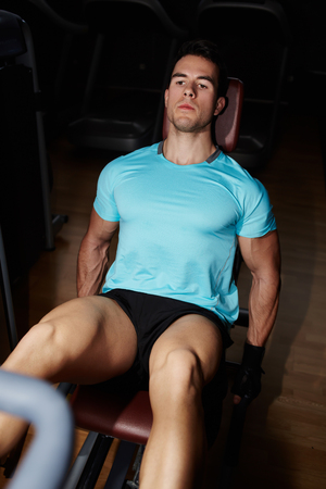 weightlifter: High angle view of male weightlifter doing leg presses in gym Stock Photo