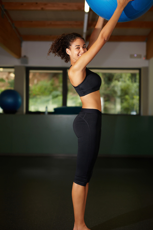 fitball: Fit afro woman with perfect body having fun after Pilates training with fit-ball