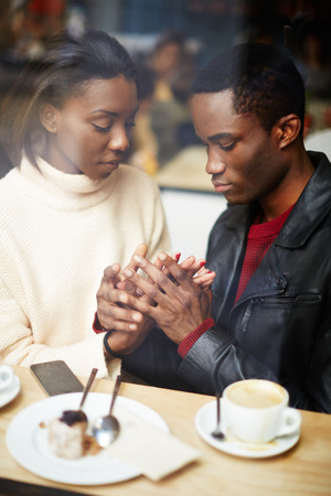 tender sentiment: Two people in cafe enjoying the time spending with each other, portrait of young couple in love at coffee shop, young couple at san valentines day, handsome man declaration of love for his girlfriend