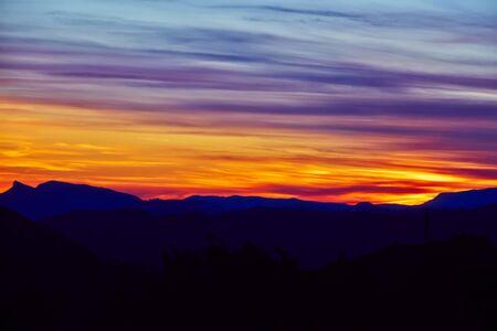 purple sunset: Purple sunset over mountain hills landscape