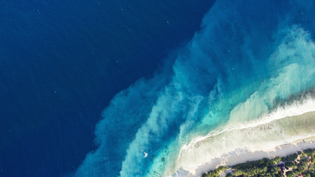 Top view aerial drone photo of Virgin Islands National Park with incredibly beautiful seashore. Velvety sandy beach and shocking blue water. Amazing nature landscape for travel website or journey blog