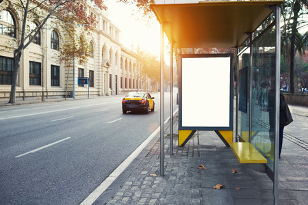 or promotional content, advertising mock up on a bus stop, public information board in urban setting, empty poster on the street at day Stock Photo