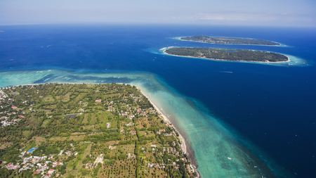 Aerial drone photo of Gili Islands with incredible diversity of marine life, from migrating whales to colourful intertidal creatures offers a truly unforgettable experience during vacations holidays