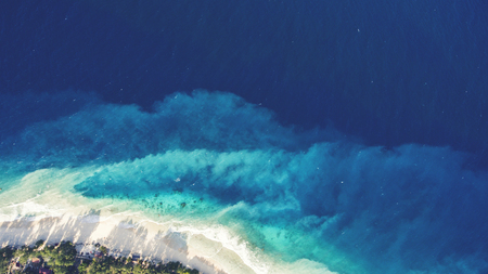 Top view aerial drone photo of fantastically stunning seashore with perfect sand and crystal clear water in a thousand shades of blue.One of the most beautiful beaches in the world. Website background