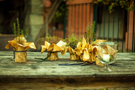 bonbonniere: rosemary in jar on a table