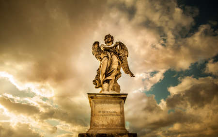 stone tombstone: Staue of angel in Rome on the sunset