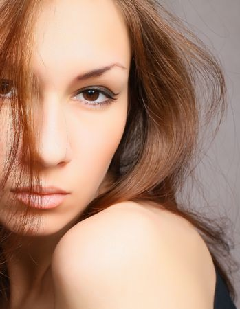 closeup of a brunette girl face photo