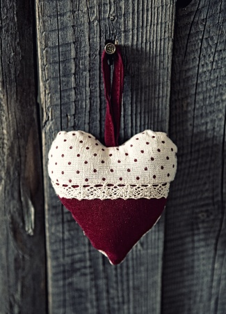 Heart on the wood background photo