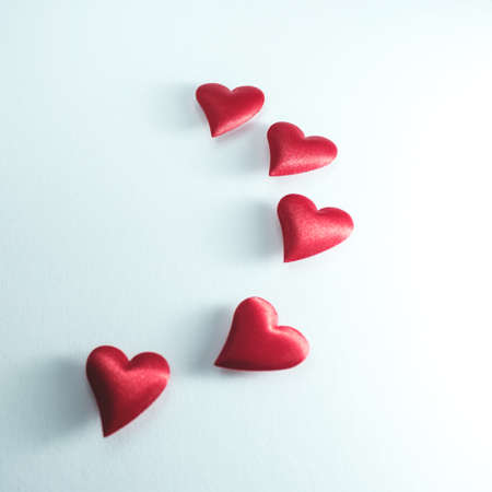 lots of little red hearts flying on white background. romantic love background for Valentines day, birthday, holiday, party, wedding. Stock Photo