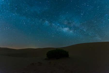 Milky way over desert Stock Photo
