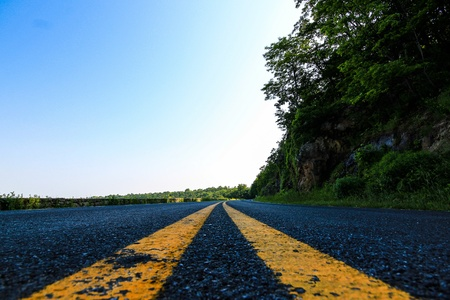 median: Road with yellow median Stock Photo