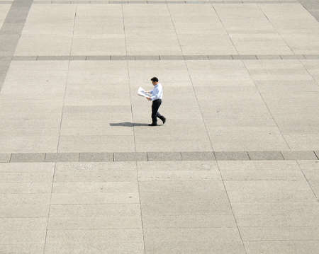 actuality: Active man walking and reading newspaper