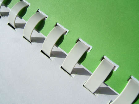 A white and green notebook with spirals close-up Stock Photo