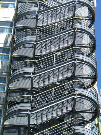 det: Metallic stairs with blue sky background