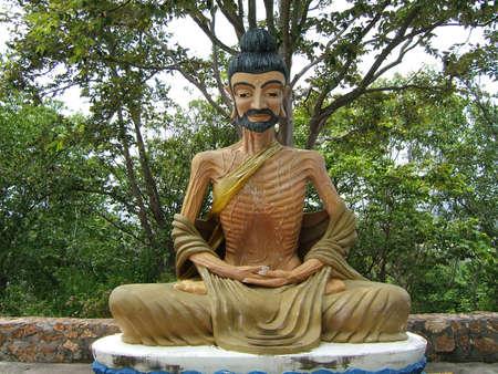 idolatry: Statue of a monk meditating - Pattaya, Thailand (Phra Tmanak Hill - Khao Phra Bat Temple)