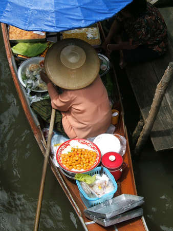 Thai woman working in floating market - Thailand - Damnoen Saduak Floating Market, neer bangkok photo