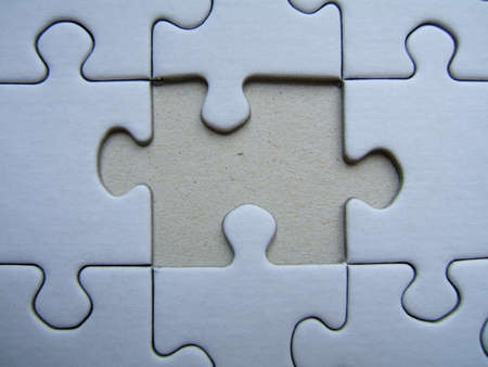 Missing element of a blue puzzle close-up