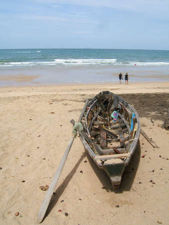 beautifu: A wooden old boat on the beach