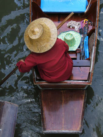 Woman in a boat in Asia