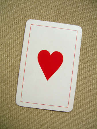 passions: Card with red heart on a browny tissue background