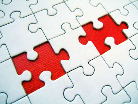 Two red jigsaw elements