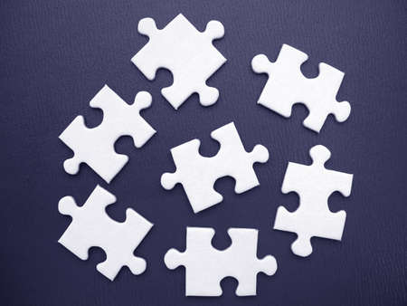White jigsaw on a blue background Stock Photo