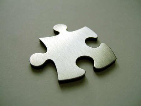 Metallic jigsaw piece