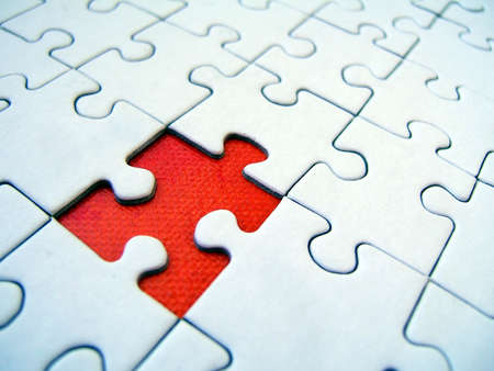 Red element of a jigsaw photo