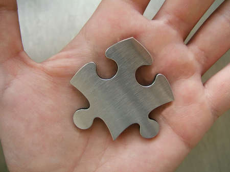 Jigsaw in a human hand