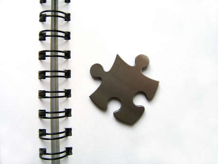 Jigsaw and spirale notebook Stock Photo - 329820