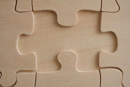 Wooden jigsaw element close-up