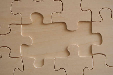 two pieces: Two missed pieces of wooden jigsaw Stock Photo