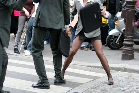 dissent: Bussinessmen and businesswoman fighting in the street (models)