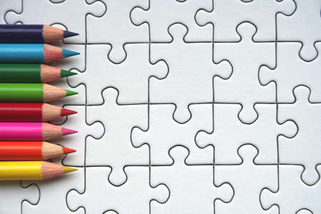 Colorful pencils on jigsaw background Stock Photo - 458310