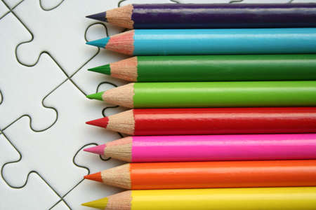 Colorful pencils on jigsaw background Stock Photo - 458307