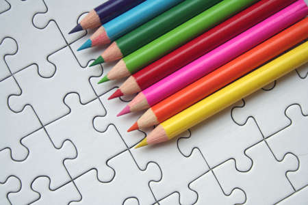 Colorful pencils on jigsaw background Stock Photo - 458305