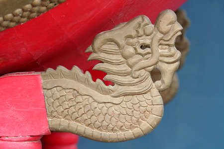 sculpted: Ancient chinese dragon sculpted in a temple