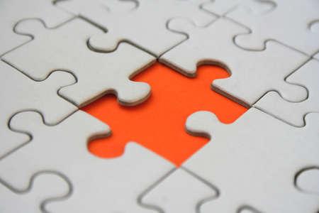 Orange jigsaw puzzle piece photo
