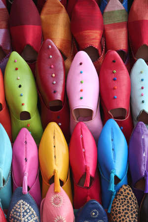 moroccan culture: Colorful aligned shoes in arabic shop