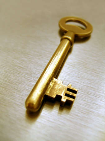 Golden color key on metallic background