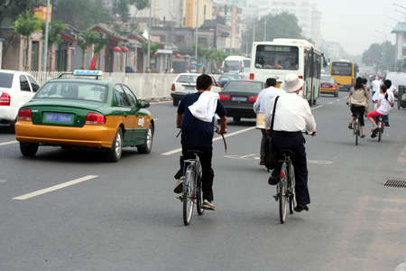 Chinese morning street scene : people going working. Picture take in Beijing.
