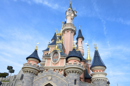 company person: FRANCE, PARIS - February 26.2016 - Facade of the Sleeping Beauty Castle in the park Disneyland Paris