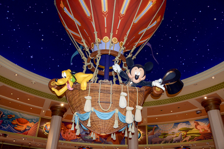 FRANCE, PARIS - February 28.2016 - The famous Mickey mouse with his dog Pluto, mounted in a hot air balloon into a souvenir shop, in the park of Disneyland Paris