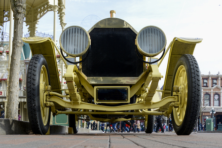 spoked: FRANCE, PARIS - February 28.2016 - Old spoked wheels with wooden car, at the entrance to Disneyland Paris