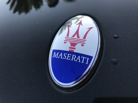 Marbella, Spain - August 10, 2018: Logo of a Maserati car parked inside the famous Puerto Banus. Luxury port where you can take a walk, have a drink and see large and luxurious yachts Editorial