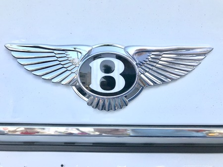 Marbella, Spain - August 10, 2018: Logo of a Bentley car parked inside the famous Puerto Banus. Luxury port where you can take a walk, have a drink and see large and luxurious yachts